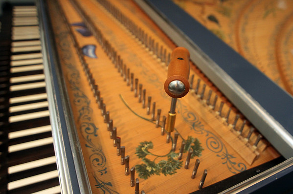 ALLEGRA BOVERMAN/Staff photo. Gloucester Daily Times. Gloucester: Detail of the harpsichord's tuning hammer, made of pearwood, by Allan Winkler, a harpsichord builder. A handpainted piece of parsley is seen also, painted by Carole Bolsey.