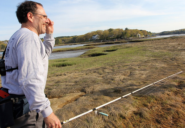 ALLEGRA BOVERMAN/Staff photo. Gloucester Daily Times. Gloucester: Mark Asaro of Gloucester heads out to fish for stripers in the Little River in Gloucester on Monday afternoon.