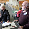 ALLEGRA BOVERMAN/Staff photo. Gloucester Daily Times. Manchester: Anne Day, left, votes as Ted Brown, right, an election official, supervises, during Manchester Election Day on Tuesday at Manchester Memorial Elementary School.