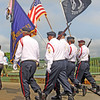 Jesse Poole/Gloucester Daily Times May 28, 2012 GLOUCESTER— Men march across the cut bridge carrying flags during the Memorial Day parade on Monday morning.