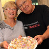 ALLEGRA BOVERMAN/Staff photo. Gloucester Daily Times.  Gloucester: Sam Lucido and his friend Agnes Burnham, both of Gloucester, with a plate of freshly baked, frosted and sprinkled cuchidata cookies that will be available at the St. Ann's Church Strawberry Festival on June 2.