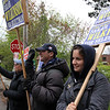 ALLEGRA BOVERMAN/Staff photo. Gloucester Daily Times. Rockport: Holding candidate signs along Jerdens Lane at Summer Street in Rockport on Tuesday afternoon are: from right to left: Isabelle Salvaterra, helping out her Boston College sailing coach Greg Wilkinson, center, and Jane Fumara.