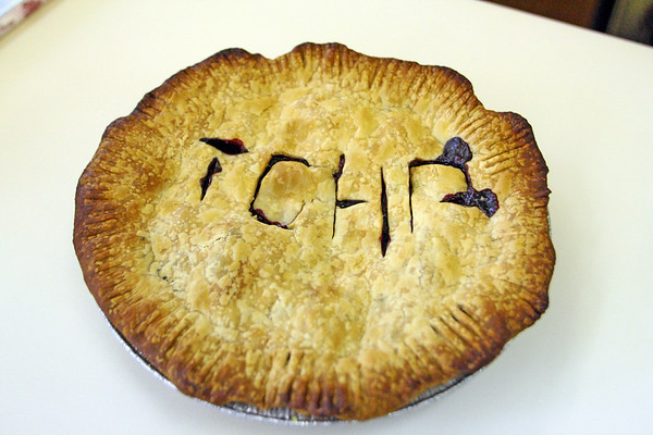"""A donated pie with """"TOPH"""" written on it shows up at the T.O.P.H. Burnham Library on Wednesday afternoon for the Annual Pie Fest Fundraiser. Jesse Poole/Gloucester Daily Times May 2, 2012"""