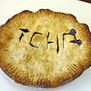 "A donated pie with ""TOPH"" written on it shows up at the T.O.P.H. Burnham Library on Wednesday afternoon for the Annual Pie Fest Fundraiser. Jesse Poole/Gloucester Daily Times May 2, 2012"