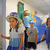 Jesse Poole/Gloucester Daily Times May 25, 2012— First-graders, from left, Cindy Haight, Andrew Gagnon and Elijah Walsh march through the halls of Essex Elementary School on  Friday morning as part of the first grade's Emperor's Parade.