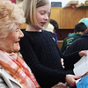 First-grader Lucy Lopardo reads to her great-grandmother, Grace Potter, who visited from New London, Connecticut for the annual Manchester Memorial Elementary School Day on Wednesday morning. Jesse Poole/Gloucester Daily Times May 2, 2012