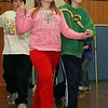 ALLEGRA BOVERMAN/Staff photo. Gloucester Daily Times. Gloucester: Veterans Memorial Elementary School fifth graders from left: Nathan Ciolino, Oriana Rowe, and Parker Caraway rehearse their ballroom dancing moves for the upcoming seventh annual Mad Hot Ball to be held on Sunday at the Gloucester High School Field House from 2-4:30 p.m. Three hundred fifth graders from across the school district will be participating and have been preparing for this for several months.