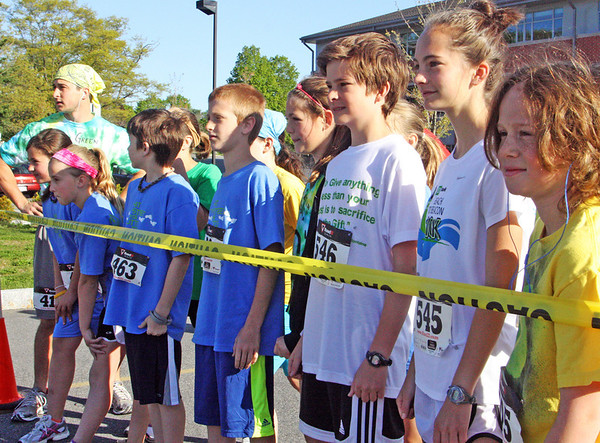 Jesse Poole/Gloucester Daily Times May 12, 2012 MANCHESTER— A group of students line up at the front of the line, mentally preparing themselves for the soon-to-start 5th Annual Hit the Streets for Little Feet 5K Road Race on Saturday morning in Manchester. Over 600 people participated, between both the 5K Road Race and the 1 Mile Fun Run that came out to support the Manchester Memorial Elementary School PTO.