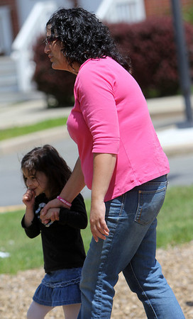 ALLEGRA BOVERMAN/Staff photo. Gloucester Daily Times. Gloucester: Allison Hammond of Gloucester playing with her daughter Lizzy Harrison, 4 1/2, after preschool on Friday afternoon. They are looking at birds nearby.