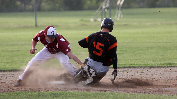 ALLEGRA BOVERMAN/Staff photo. Gloucester Daily Times. Gloucester: Gloucester High School's Ben Favazza, left, tries to prevent Beverly's Harry Brown from getting onto second base during their game in Gloucester on Friday evening.