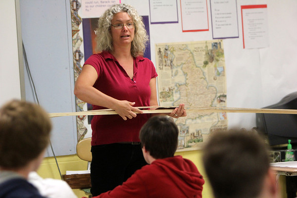 ALLEGRA BOVERMAN/Staff photo. Gloucester Daily Times. Gloucester: O'Maley Middle School teacher Caitlin Sumner talks with eighth graders on Wednesday about how to build bridges. They were learning to draw bridge designs to scale on paper.