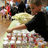 "ALLEGRA BOVERMAN/Staff photo. Gloucester Daily Times. Gloucester: <br /> Veterans Memorial Elementary School fourth grader Sean Brown mans the snack table that this week is full of yogurt, at the Mobile Market set up by The Open Door at Veterans Memorial Elementary School on Friday afternoon. He makes sure every person who comes to the table says ""please"" and ""thank you.""The Mobile Market has been in service for seven years in Cape Ann and is in its second year at Veterans Memorial. About 100 families are served by the program, and there is a snack table for kids and adults alike that rotates goodies from week to week. Mobile Market is a free farmers market, which provides fresh produce and groceries at four neighborhood-based, two school-based, and two senior center-based market sites that include: Riverdale Park, Willowood Gardens, Millbrook Park, Rockport, Pathways for Children, Agawam Village, Ipswich, and Veterans Memorial Elementary School."