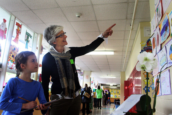 Lyn Shields of Beverly Farms points to her second grade granddaughter Luli Bartlett's drawing of the moon during Manchester Memorial Elementary School Day on Wednesday morning. Jesse Poole/Gloucester Daily Times May 2, 2012