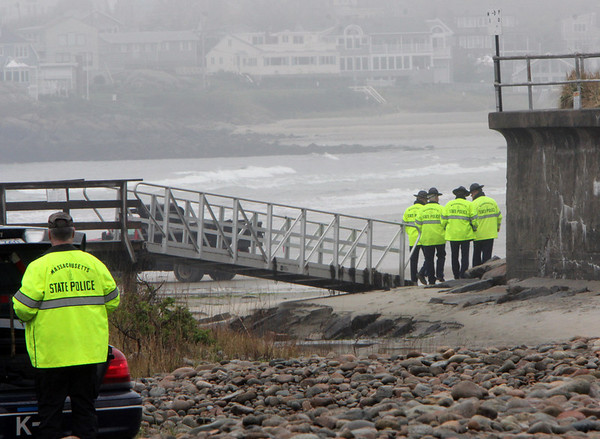 ALLEGRA BOVERMAN/Staff photo. Gloucester Daily Times. Rockport: State police gather before searching Long Beach again on Friday afternoon.