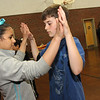 ALLEGRA BOVERMAN/Staff photo. Gloucester Daily Times. Gloucester: Veterans Memorial Elementary School fifth graders Julieka Rodrigues and Jacob Russell rehearse their ballroom dancing moves for the upcoming seventh annual Mad Hot Ball to be held on Sunday at the Gloucester High School Field House from 2-4:30 p.m. Three hundred fifth graders from across the school district will be participating and have been preparing for this for several months.