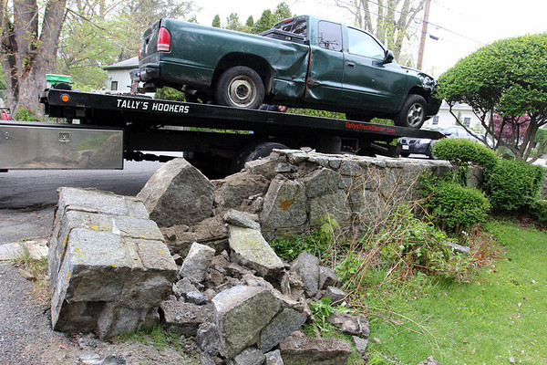 ALLEGRA BOVERMAN/Staff photo. Gloucester: A man driving this pickup truck crashed into this home at 1113 Washington Street, the home of Heather Wojciak. The truck heavily damaged her stone wall at the edge of her driveway. Airbags deployed in the truck. Firefighters said he did not negotiate a curve correctly as he turned onto Washington where it splits from Route 127. He was able to get back to his home around the corner and was examined there by firefighters.
