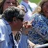 ALLEGRA BOVERMAN/Staff photo. Gloucester Daily Times. Gloucester: Retiring Gloucester High School Principal William Goodwin, left, jokes <br /> on Thursday afternoon during a surprise tribute to him by the entire school population. At center is science department head Rachel Rex, and at right is Gloucester Mayor Carolyn Kirk.