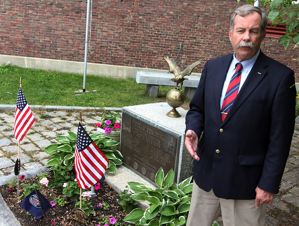 ALLEGRA BOVERMAN/Staff photo. Gloucester Daily Times. Gloucester: Gloucester lawyer Mark Nestor, who heads the Disabled American Veterans Chapter #74, and was a pilot during the Vietnam War, at the Vietnam Memorial at Gloucester High School on Monday. The city's Memorial Day ceremonies this year will skip this location.