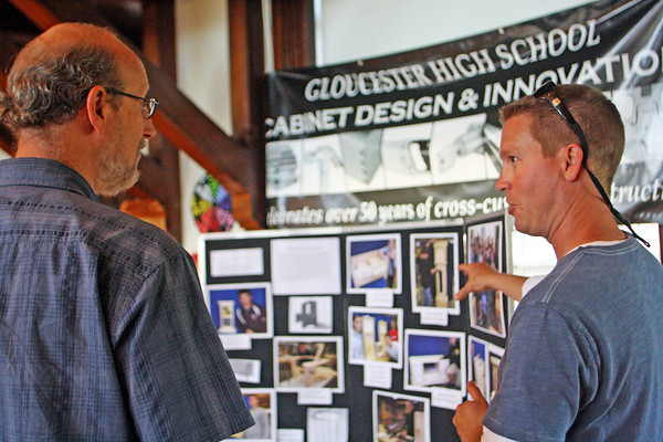 Jesse Poole/Gloucester Daily Times May 12, 2012 GLOUCESTER— Tim Rose, teacher of cabinet design at Gloucester High School, talks with Richard Safier, superintendent of Gloucester public schools at City Hall during the Gloucester Public School Arts Festival on Saturday.