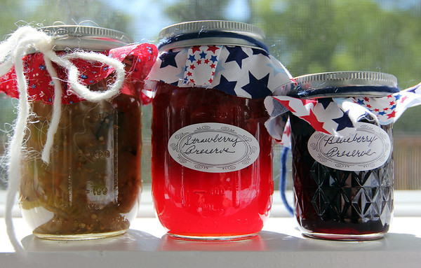 ALLEGRA BOVERMAN/Staff photo. Gloucester Daily Times.  Gloucester: Some of the homemade foods available for sale during the St. Ann's Strawberry Festival to be held June 2. From left are: gabaledina, made of eggplant, celery, tomatoes, olives and onions, strawberry and blueberry preserves.