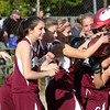 ALLEGRA BOVERMAN/Staff photo. Gloucester Daily Times. Gloucester: Gloucester's varsity girls softball team celebrates their win against Lynnfield in Gloucester on Friday afternoon. Gloucester beat Lynnfield 6-5.