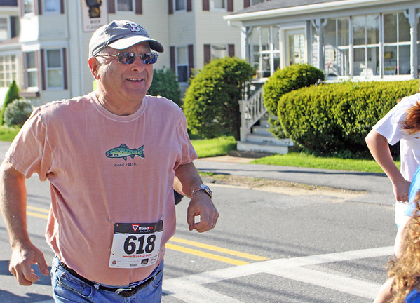 Jesse Poole/Gloucester Daily Times May 12, 2012 MANCHESTER— Greg Bialy, 64, of Manchester, makes his way down Lincoln Street for the 5th Annual Hit the Streets for Little Feet 5K Road Race, which, along with the one-mile fun run afterward, drew an upwards of 600 people.