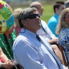 ALLEGRA BOVERMAN/Staff photo. Gloucester Daily Times. Gloucester: Retiring Gloucester High School Principal William Goodwin makes funny faces at the senior class seated in the bleachers on Thursday afternoon during a surprise tribute to him by the entire school population held at Newell Stadium. Gloucester Mayor Carolyn Kirk, at right, laughs with him.