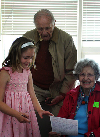 First-grader Annabel Smith shows her writing to her grandparents Bill and Alice Moir, who visited from Hanover, New Hampshire on Wednesday morning to celebrate Manchester Memorial Elementary School Day. Jesse Poole/Gloucester Daily Times May 2, 2012