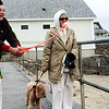 Joan Kelley, left, of Rockport, visits Front Beach with Emmie, a dog  she's sitting, and throws her a tennis ball, as Barbara Schick of Rockport watches with her dog Leroy. Jesse Poole/Gloucester Daily Time May 2, 2012