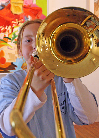 Jesse Poole/Gloucester Daily Times May 12, 2012 GLOUCESTER— Jemima Grow, 10, practices on the trombone at the Cape Ann Museum on Saturday during the Gloucester Public School Arts Festival.