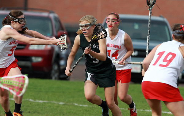 Manchester-Essex attacker Taylor Meek (5) center, weaves through a couple Masco defenders on Wednesday afternoon. David Le/Staff Photo