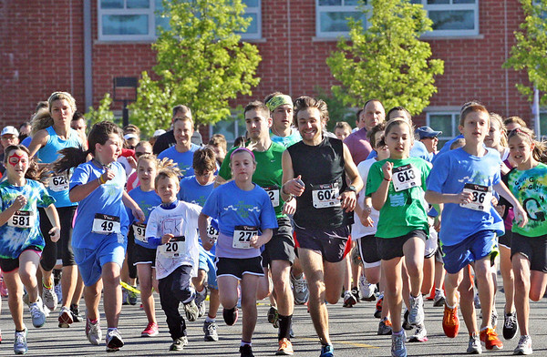 Jesse Poole/Gloucester Daily Times May 12, 2012 MANCHESTER— Runners take their first strides in the 5th Annual Hit the Streets for Little Feet 5K Road Race on Saturday morning in Manchester.  Over 600 people participated, between both the 5K Road Race and the 1 Mile Fun Run that came out to support the Manchester Memorial Elementary School PTO.