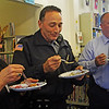 "Each with a different kind of pie in hand, from left, Mary Elinor Dagle, Police Officer Rob Gilardi and Chief of Police Peter Silva visit the T.O.P.H. Burnham Library on Wednesday afternoon for the Annual Pie Fest Fundraiser, which benefits the library. ""Not my first piece of pie, and it won't be my last,"" joked Gilardi. Jesse Poole/Gloucester Daily Times May 2, 2012"