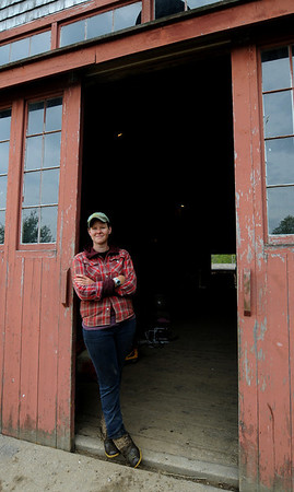 Essex: Liz Green, of the Apple Street Farm in Essex,poses at her barn door. JIm Vaiknoras/staff photo