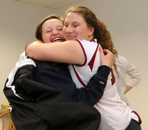 ALLEGRA BOVERMAN/Staff photo. Gloucester Daily Times. Gloucester: Audrey Knowlton, left, a Gloucester High School senior, signed her letter of intent to play basketball for New York Institute of Technology on Wednesday afternoon. Fellow senior Hayley Labrecque gives her a huge hug.