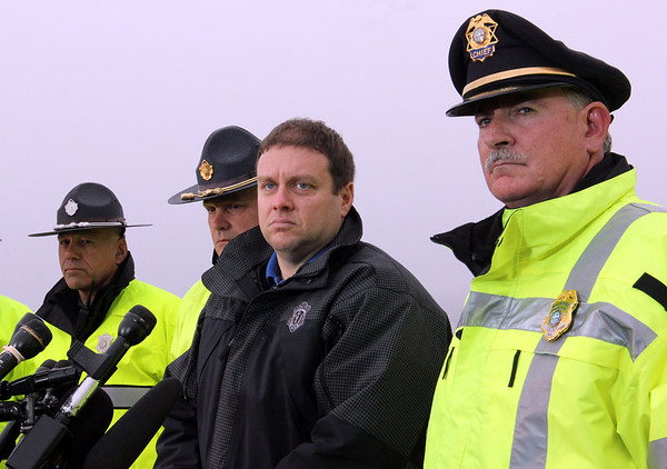 "ALLEGRA BOVERMAN/Staff photo. Gloucester Daily Times. Rockport: State and Rockport police searched Long Beach again on Friday afternoon. They held a press conference afterwards. State Police spokesman David Procopio, center, and Rockport Police Chief John ""Tom"" McCarthy, at right, speak with the media along with other members of the State Police."
