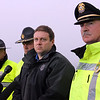 """ALLEGRA BOVERMAN/Staff photo. Gloucester Daily Times. Rockport: State and Rockport police searched Long Beach again on Friday afternoon. They held a press conference afterwards. State Police spokesman David Procopio, center, and Rockport Police Chief John """"Tom"""" McCarthy, at right, speak with the media along with other members of the State Police."""