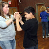 ALLEGRA BOVERMAN/Staff photo. Gloucester Daily Times. Gloucester: Veterans Memorial Elementary School fifth graders Taylor Bigelow and Jose Rodrigues rehearse their ballroom dancing moves for the upcoming seventh annual Mad Hot Ball to be held on Sunday at the Gloucester High School Field House from 2-4:30 p.m. Three hundred fifth graders from across the school district will be participating and have been preparing for this for several months.