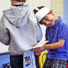 Jesse Poole/Gloucester Daily Times May 25, 2012— First-grader Connor Fitzgerald acts as a goat and headbutts his classmate Brady Friedrich in a skit with parents in the audience at Essex Elementary School on Friday morning.