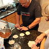 ALLEGRA BOVERMAN/Staff photo. Gloucester Daily Times.  Gloucester: Sam Lucido and his friend Agnes Burnham, both of Gloucester, prepare cuchidata cookies that will be available at the St. Ann's Church Strawberry Festival on June 2.