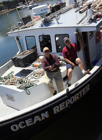 ALLEGRA BOVERMAN/Staff photo. Gloucester Daily Times. Rockport: Bill Lee, right, and Bob Smith, both of Rockport, aboard Lee's new Ocean Reporter, for which there will be ceremony on Friday.