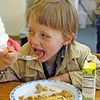 Fletcher Wilson, 4, of Essex, thoroughly enjoys his apply pie at the T.O.P.H. Burnham Library on Wednesday afternoon at the Annual Pie Fest fundraiser. Jesse Poole/Gloucester Daily Times May 2, 2012