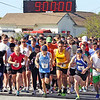 Jesse Poole/Gloucester Daily Times May 12, 2012 GLOUCESTER— Runners begin the Twin Lights Half Marathon on Saturday morning with a burst from the starting line at Good Harbor Beach. Runner Number 1, Ryan Miller of Andover, went on to finish in second place at one hour, 18 minutes and 34 seconds.