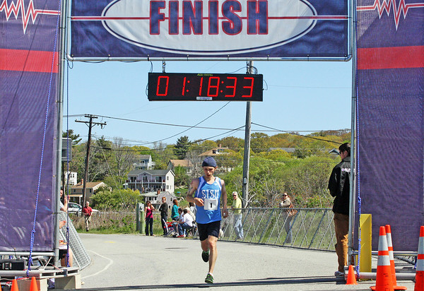 Jesse Poole/Gloucester Daily Times May 12, 2012 GLOUCESTER— Coming in at one hour, 18 minutes and 34 seconds, Ryan Miller of Andover sets foot behind the finish line of the Twin Lights Half Marathon at Good Harbor Beach on Saturday afternoon.