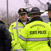 """ALLEGRA BOVERMAN/Staff photo. Gloucester Daily Times. Rockport: State and Rockport police searched Long Beach again on Friday afternoon. They held a press conference afterwards. State Police spokesman David Procopio, far left, and Rockport Police Chief John """"Tom"""" McCarthy, center, and other State Police talk before holding their press conference."""