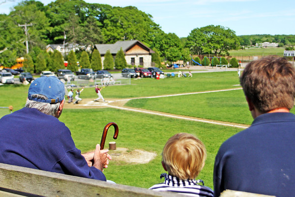 Jesse Poole/Gloucester Daily Times May 23, 2012 ESSEX— From left, Dennis Henderson, Chase Koeplin and his dad Chris, watch Manchester/Essex play Rockport in a Cape Ann League baseball game in Essex on Wednesday afternoon.