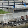 ALLEGRA BOVERMAN/Staff photo. Gloucester Daily Times. Gloucester: The seawall in the vicinity of Blynman Bridge at Stacy Boulevard is crumbling in many areas.