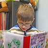 First-grader Jonah Stevens reads a book, which he authored and illustrated, to Jennifer Roberts, the principal of Essex Elementary School on Tuesday afternoon. He was awarded a certificate in recognition for his good work. Jesse Poole/Gloucester Daily Times May 1, 2012