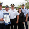 ALLEGRA BOVERMAN/Staff photo. Gloucester Daily Times. Essex: Members of the Coast Guard Auxiliary, Essex Police and Harbormaster, Sen. Bruce Tarr and State Representative ANN-MARGARET FERRANTE were on hand at the Essex Town Landing to promote safe boating and hung new signage alerting boaters to educational and volunteer opportunities with the U.S. Coast Guard Auxiliary's Cape Ann Flotilla 46, run by volunteers. There will be 15 such signs placed all around Cape Ann. There will be a Safe Boating Day on June 2 from 10 a.m. - 2 p.m. at the Essex Town Landing and at marinas nearby with boat inspections and recreational boat safety as the focus, plus, boats on trailers can be inspected behind the police station. From left are Sen. Bruce Tarr, Auxiliary Division Commander Damien Benson, Barry Dumoulin of the Harbor Patrol, Essex Police Chief Peter Silva,  State Rep. Ann-Margaret Ferrante, Auxiliary Public Affairs Officer Phil Karwowski, Paddle Smart coordinator Bob Amiro and John Keyes, Vice Flotilla Commander.