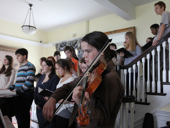 "ALLEGRA BOVERMAN/Staff photo. Gloucester Daily Times. Rockport: The Rockport High School Chorus performed songs from ""Fiddler on the Roof"" for the Rockport Rotary Club on Thursday morning at the Emerson Inn. Music Director Jim Davison is a member of the club. He is soon retiring from teaching in the school district. Madeleine Downs played violin during the performance."